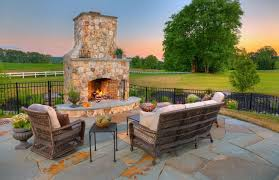 an outdoor fireplace vs a fire pit get tips to answer this landscape design