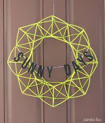 front door wreath15 DIY Wreaths to Decorate Your Front Door This Summer