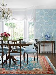 lotus wallpaper nice against the turquoise and rich red persian rug