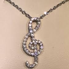 diamond treble clef necklace