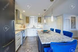 Well Appointed Kitchen Features A Large Kitchen Island Topped
