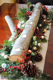 diy holiday log centerpiece with natural greenery berries