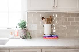 it has such a pretty glaze finish and adds the right amount of contrast between the backsplash and the creamy white cabinets