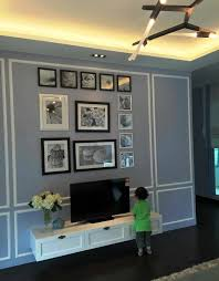 wainscoting in combination with black and white frames and the simple tv panel minimal but so pleasing to the eyes