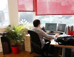 Natural light office Commercial Man Working Inside The Office Using Natural Light Alsco Why You Should Start Using Natural Light In Your Workplace Alscoconz