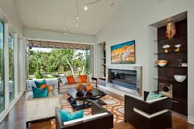 View in gallery Orange and turquoise accents bring in a bold and bright  contrast