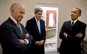 10 president obama talks with vice president biden and secretary of state john kerry in the hallway outside the oval office prior to entering the barack obama enters oval