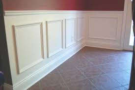 use simple trim to create a wainscot by adding a chair rail and picture frame panels