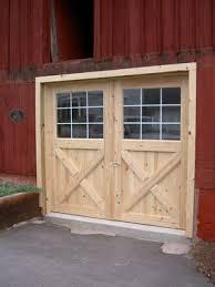 hinged barn doors. New Swinging Barn Doors On Old Hinged