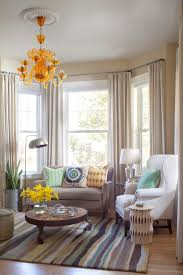 furniture for bay window. Denver Bay Window Treatments Living Room Transitional With Orange Chandelier Wingback Chairs Furniture For