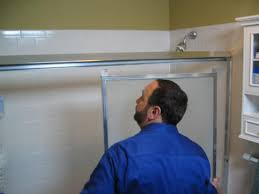 before you can install the bottom and side jambs of the new tub and shower door