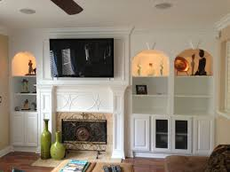 a fireplace mantel surround and build in is a great way to turn an ordinary living room into an elegant refined space the mantel is the heart of the
