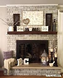 wood mantel on brick fireplace brick fireplace mantel love the whitewashed brick stone slab on the