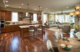 define spaces with area rugs traditional open space floor plan