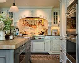English Country Kitchen With White Cabinets And Wall Mounted Pot Rack Over  Range