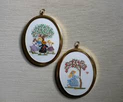 these cross stitch pictures were made by me back in the early 1980 s and are stitched on very fine aida using embroidery threadounted into a couple