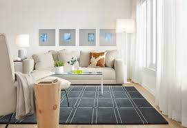 bridge rug with cowhide pillow and reclaimed wood stool