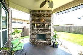 covered patio fireplace cost to build with tv porch covered patio with fireplace