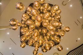 tom dixon lighting sculpture at the new hilton hotel in estonia over 200 mirror ball