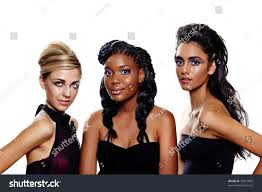 three beautiful women of diffe races with diffe makeup and fashion hairstyles over white background