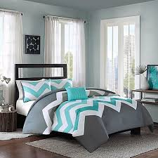 Add a pop of color to your bed with the eye-catching Cade Reversible  Comforter