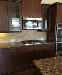 gourmet kitchen with easy to clean cooktop beautiful mexican travertine tumble stone subway tile backsplash