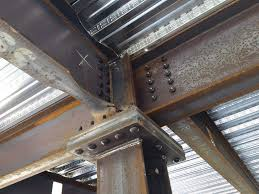 the thermally broken steel plate connection supports steel girders under the galvanized pan for the