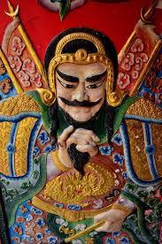 Asian merchant deity carrying bag