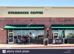 starbucks store exterior. Perfect Starbucks The Exterior Of A Starbucks Coffee House Showing Customers On An Outdoor  Patio Memorial Road In Store Exterior O