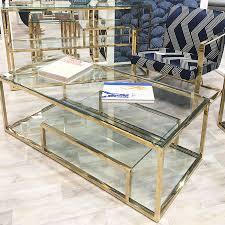 lucia gold glass multi shelf coffee table