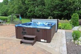 patio ideas with hot tub. Unique Ideas This Above Ground Backyard Hot Tub Is Set On A Brick Patio And Surrounded  By Natural Greenery As Well An Inviting Outdoor Living Space With Patio Ideas Hot Tub O