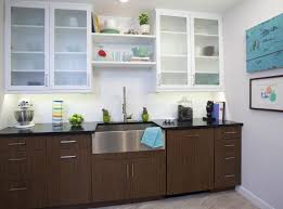 illuminated white and brown two tone kitchen cabinet with wall mount shelving