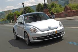 2012 Reflex Silver VW Beetle Turbo Driving Front - | EuroCar News