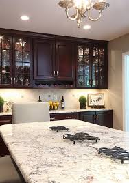 bianco romano granite countertops dark kitchen cabinets contemporary kitchen ideas
