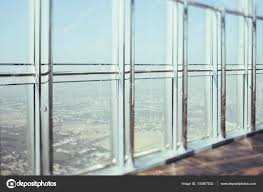 office glass windows. View From Skyscraper Window, Inner Bright Chrome And Glass Modern Contemporary Interior With Reflections, Cityscape Outside, Dubai, Tilt Shift Shooting Office Windows