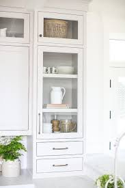 light gray glass front cabinetry