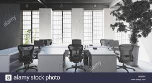 modern interior office. simple modern empty white desks with chairs in modern minimalist interior office against  big bright windows and huge inside modern interior office