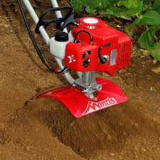 2 cycle tiller digging close up