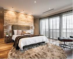 photo of cool black white white leather bedroom with feature wall padded  wallpaper