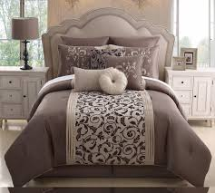 dark brown bedding set with curving and leaves pattern on the gray base placed on the brown bed with curving head board
