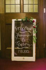 Signage On Glass Of An Old Window Frame By Creating Wedding Welcome Sign Diy Weddings Sarah Types Decor Most Delightful Way Budget Sarahtypes Hand Lettered