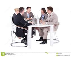 people sitting at table white background. royalty-free stock photo. download business people having conference meeting over white background sitting at table w