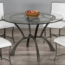 greenwich round glass dining table by wesley allen shown in a silver bisque finish