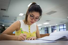 persuasive essay and speech topics ereading worksheets this is an image of a young w writing an essay she is in a