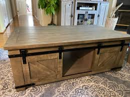By jonathan charles fine furniture. Signature Design By Ashley Aldwin Weathered Gray Sliding Barn Door Storage Coffee Table Big Lots