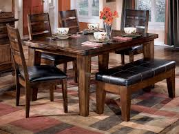 dining room pub style sets: old antique pub style dining sets with varnish dining table and  wooden dining chairs with black leather seats and bench seats plus carpet tiles