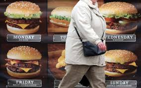 who governments should regulate fast food to slow obesity a w passes an advertisement outside a fast food restaurant on jan 7 2013 in bristol england matt cardy getty images