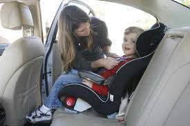 child in a forward facing car seat