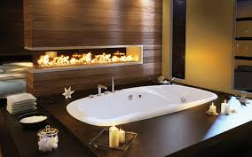 bathroom contemporary bathroom with oval bathtub on wooden panels with candles and electric fireplace contemporary