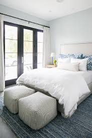 light gray upholstered bed with blue